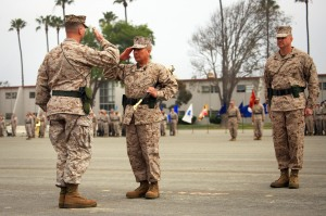 Sgt. Maj. Juan M. Hidalgo Jr. (center), outgoing sergeant major of 13th Marine Expeditionary Unit, salutes Col. Christopher D. Taylor (left), commanding officer of 13th MEU, during a relief and appointment ceremony at Camp Pendleton, Calif., March 15. The incoming sergeant major is Sgt. Maj. William S. Slade (right), who served 15 months as the squadron sergeant major of Marine Aviation Logistics Squadron 39, Marine Aircraft Group 39.