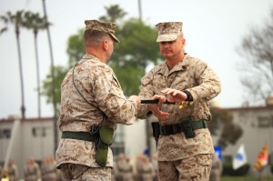 Col. Christopher D. Taylor (left), commanding officer of 13th Marine Expeditionary Unit, passes the noncommissioned officer's sword to Sgt. Maj. William S. Slade (right), incoming sergeant major of 13th MEU, during a relief and appointment ceremony at Camp Pendleton, Calif., March 15. Slade previously served 15 months as the squadron sergeant major of Marine Aviation Logistics Squadron 39, Marine Aircraft Group 39.